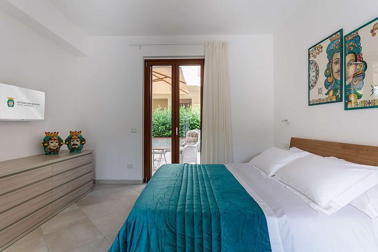 Camera matrimoniale con patio - Casa vacanze Zagara